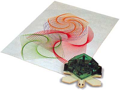 Photo of a turtle robot that has made a design on a sheet of paper